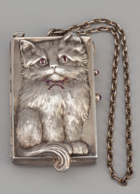 A CONTINENTAL SILVER, SILVER GILT AND GARNET CAT-FORM COMPACT Maker unidentified, circa 1920 Marks: L</