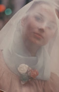 Photographs:20th Century, SAUL LEITER (American, b. 1923). Untitled (Woman'sPortrait), 1960. Ektacolor , printed later. 14 x 11 inches(35.5 x 27...