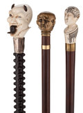 Decorative Arts, Continental:Other , COLLECTION OF THREE UNUSUAL HUMAN HEAD FORM CANES, CIRCA 1850 .36-1/4 inches overall length of devil (92.1 cm). 36 inches ...