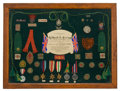 Decorative Arts, British:Other , MALCOLM S. FORBES COLLECTION: LOVINGLY COMPILED PRESENTATION OFAWARDS AND BADGES EARNED BY CPL. HAROLD A. SEARING OF THE FIR...