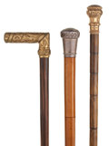 Decorative Arts, Continental:Other , GROUP OF THREE CANES WITH METAL HANDLES, ONE WITH CONCEALED SWORD.36 inches overall length of gilt knob cane (91.4 cm). 34 ...(Total: 3 Items)