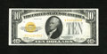 Small Size:Gold Certificates, Fr. 2400 $10 1928 Gold Certificate. About Uncirculated.. A light center fold is noticed at center....