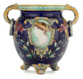 Ceramics & Porcelain, British:Modern  (1900 1949)  , A VICTORIAN MAJOLICA TWO-HANDLED FOOTED JARDINIÈRE . Unknown maker,Staffordshire, England, circa 1875. Marks to foot: H ...