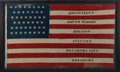 Political:Textile Display (1896-present), Theodore Roosevelt: A Large Flag from the 1900 Rough Rider Reunion in Oklahoma City....
