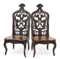 A PAIR OF AMERICAN ROCOCO REVIVAL LAMINATED ROSEWOOD CHAIRS Unknown maker, New York, New York or Philadelphia, Pe