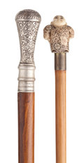 Decorative Arts, Continental:Other , SILVERED METAL HIDDEN COMPARTMENT CANE AND IVORY FIGURAL CANE .38-3/4 inches overall length of secret compartment cane (98....(Total: 2 Items)