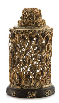 A JAPANESE CARVED IVORY JAR WITH LID ON WOOD AND IVORY STAND Unknown maker, Japan, circa 1890 Unmarked 9-1/