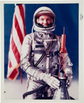 Autographs:Celebrities, Gordon Cooper Signed Color NASA Glossy Spacesuit Photo from the Personal Collection of Astronaut Roger Chaffee. ...