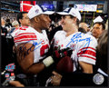 Football Collectibles:Photos, Eli Manning and Michael Strahan Multi Signed Photograph....