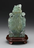 Asian:Chinese, CHINESE CARVED COVERED VASE. Chinese carved covered vase, possiblyflorite, with stylized foliage and animal finial. With ...