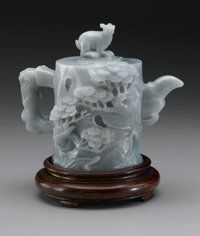 CHINESE CARVED JADE/HARDSTONE TEAPOT  Chinese carved jade/hardstone teapot with designs of pines all over and a cover wi...