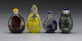 Asian:Chinese, CHINESE CARVED OVERLAY SNUFF BOTTLES. Four Chinese carved overlayglass snuff bottles on clear ground; one with yellow ove... (Total:4 )