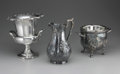 Miscellaneous: , TWO SILVER PLATE WINE COOLERS AND PITCHER. Two silver plate wine coolers, both with double handles and floral designs; tog... (Total: 3 )