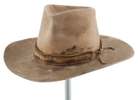 "Featured item image of A Cowboy Hat from ""Big Jake,"" ""The Cowboys,"" and ""The Train Robbers.""..."