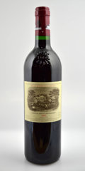 Red Bordeaux, Chateau Lafite Rothschild 2002 . Pauillac. Bottle (12). ...(Total: 12 Btls. )
