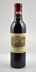 Red Bordeaux, Chateau Lafite Rothschild. Pauillac. 2002 Bottle (5). 2002Half-Bottle (6). ... (Total: 5 Btls. & 6 Halves. )