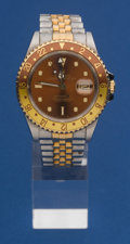 Timepieces:Wristwatch, Rolex Steel & Gold GMT Master II Wristwatch, circa 1991. ...