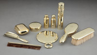 A TEN-PIECE TIFFANY GOLD GENTLEMAN'S DRESSING SET Tiffany & Co., New York, New York, circa 1910 Marks: TIFF