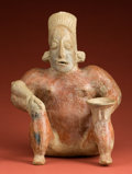 Pre-Columbian:Ceramics, Large Seated Jalisco Male with a Bowl and Warclub...