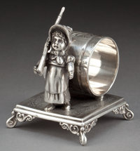 A SIMPSON, HALL, MILLER SILVER-PLATED FIGURAL NAPKIN RING Simpson, Hall, Miller & Co., Wallingford, Connecticut
