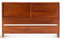 FROM THE ESTATE OF EVA SHURE  GEORGE NAKASHIMA (American, 1905-1990) WALNUT SLANT-FRONT DOUBLE HEAD BOARD WITH TWO SLID...
