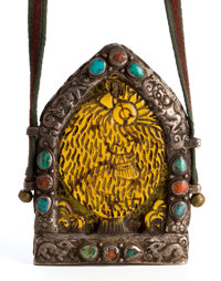HIMALAYAN CARVED AMBER AND SILVER PENDANT SET WITH TURQUOISE AND CARNELIAN 5-3/4 inches high (14.6 cm)