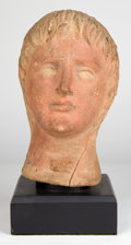 Antiquities:Greek, Antiquities: ETRURIA. Etruscan terracotta head of a young man. Ca.4th-3rd century BC. ...