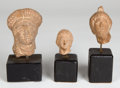 Antiquities:Greek, Antiquities: GREEK. Etruria-Alexandria, ca. 300-100 BC. Lot ofthree Hellenistic clay heads. ... (Total: 3 items)