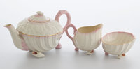 Whoopi Goldberg Collection  THREE-PIECE BELEEK GILT WHITE AND PINK PORCELAIN SHELL-FORM TEA SET