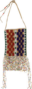 American Indian Art:Beadwork and Quillwork, A SIOUX BEADED HIDE POUCH...