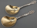Silver Flatware, American:Tiffany, A PAIR OF TIFFANY & CO. BLACKBERRY PATTERN SILVER ANDSILVER GILT CASSEROLE SERVING SPOONS . Tiffany & Co., New ...(Total: 2 Items)