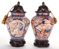 Asian:Chinese, PAIR OF JAPANESE PORCELAIN VASES IN THE IMARI PALETTE WITH CARVEDWOODEN STANDS AND COVERS . 20th century. 20 inches high (5...(Total: 2 Items)