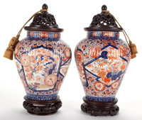 PAIR OF JAPANESE PORCELAIN VASES IN THE IMARI PALETTE WITH CARVED WOODEN STANDS AND COVERS 20th century 20 inc