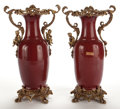 Furniture : Continental, PAIR OF CHINESE SANG DE BOEUF PORCELAIN VASES WITH LOUIS XVSTYLE GILT BRONZE MOUNTS . 20th century. 29 inches h... (Total: 2Items)