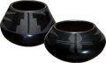 American Indian Art:Pottery, TWO SAN ILDEFONSO BLACKWARE JARS. Maria and Julian Martinez andIsabel Montoya. c. 1940... (Total: 2 Items)