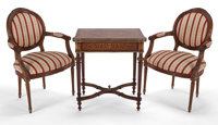 LOUIS XVI STYLE CARVED MAHOGANY AND UPHOLSTERED THREE PIECE SUITE COMPRISING SETTEE AND TWO FAUTEUILS WITH A LOUIS XVI S...