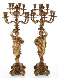 PAIR OF GILT BRONZE FIGURAL EIGHT-LIGHT CANDELABRAS Continental, 20th century 40 inches HIGH (101.6 cm) <