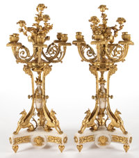 PAIR OF NAPOLEON III TEN-LIGHT GILT BRONZE AND MARBLE FIGURAL CANDELABRA France, circa 1875 34-1/2 inches high