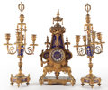 , CHARLES X STYLE THREE PIECE GILT BRONZE AND ENAMEL CLOCK GARNITURE . France, circa 1870. 23-1/2 inches high (59.7 cm) (cande...