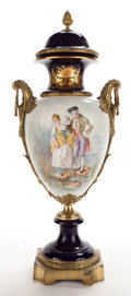 Decorative Arts, French:Other , SEVRES STYLE PORCELAIN COVERED URN WITH FIGURAL SCENE SET IN GILTBRONZE MOUNTS. France, 19th century. Marks: (pseudo Sevres...