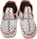 American Indian Art:Beadwork and Quillwork, A PAIR OF PLAINS BEADED HIDE MOCCASINS...