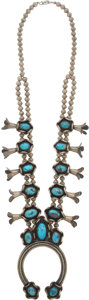 American Indian Art:Jewelry and Silverwork, A NAVAJO SILVER AND TURQUOISE SQUASH BLOSSOM NECKLACE...