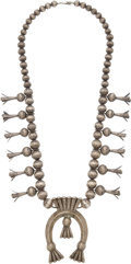 American Indian Art:Jewelry and Silverwork, A NAVAJO SILVER SQUASH BLOSSOM NECKLACE...