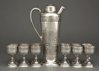 A SANBORNS MEXICAN SILVER COCKTAIL SHAKER WITH TWELVE CUPS Sanborns, Mexico City, Mexico, circa 1950 Marks: