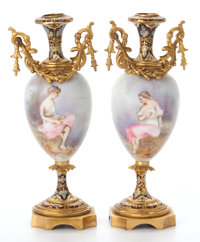 PAIR OF SÈVRES STYLE PORCELAIN CABINET VASES SET IN CHAMPLEVÉ ENAMELED GILT BRONZE MOUNTS France, circa 19...