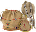 American Indian Art:Beadwork and Quillwork, THREE SOUTHERN PLAINS BEADED HIDE DRAWSTRING POUCHES. c. 1930...(Total: 3 Items)