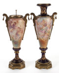 Furniture : French, PAIR OF SÈVRES STYLE PORCELAIN URNS WITH GILT BRONZE MOUNTS PAINTEDWITH CHERUBIC SCENES BY CHARLES FUCHS . Fran... (Total: 2 Items)