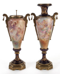PAIR OF SÈVRES STYLE PORCELAIN URNS WITH GILT BRONZE MOUNTS PAINTED WITH CHERUBIC SCENES BY