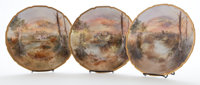 THREE ROYAL WORCESTER LANDSCAPE PLATES WITH GILT AND TOOLED RIM England, 20th century Marks: J. Hughs , ROY