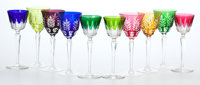 TWENTY-FOUR BACCARAT CUT TO CLEAR STEMWARE IN ASSORTED COLORS, TOGETHER WITH SIX ASSOCIATED STEMS France, 20th ce